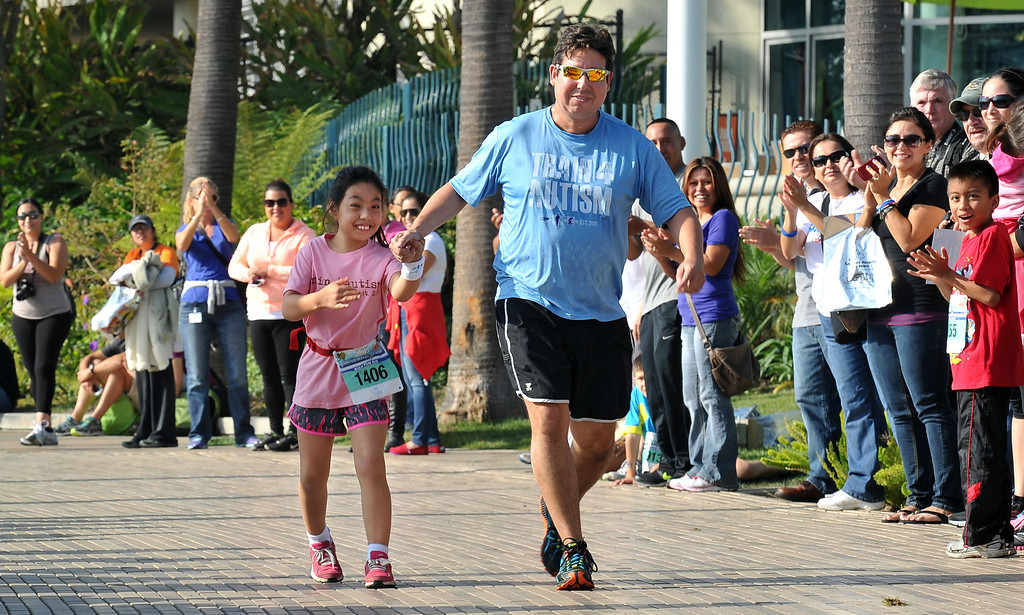 . 10/12/13 - Naomi Moran and her dad, Michael Moran running for Train 4 Autism at The Aquarium of the Pacific Kids Fun Run the day before the Long Beach International City Bank marathon & half marathon. (Photo by Brittany Murray/Press Telegram)