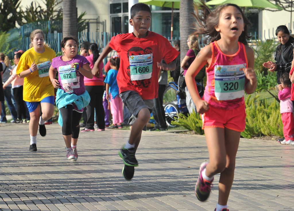 . 10/12/13 - Eleven year old runners at the finish of The Aquarium of the Pacific Kids Fun Run the day before the Long Beach International City Bank marathon & half marathon. (Photo by Brittany Murray/Press Telegram)