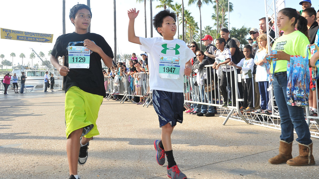 . 10/12/13 - Runners cross the finish line at The Aquarium of the Pacific Kids Fun Run the day before the Long Beach International City Bank marathon & half marathon. (Photo by Brittany Murray/Press Telegram)