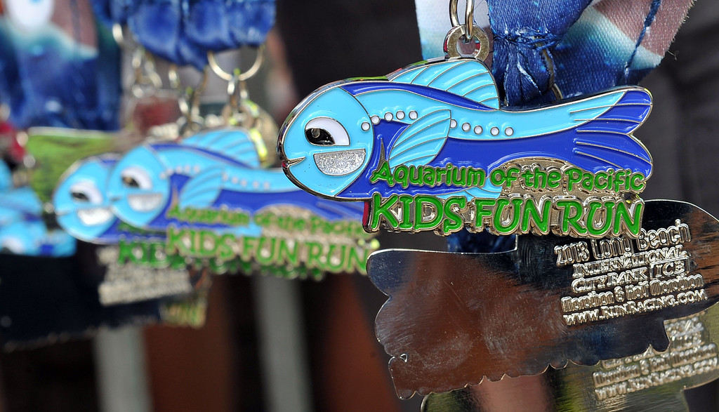 . 10/12/13 - Runners received these medals at The Aquarium of the Pacific Kids Fun Run the day before the Long Beach International City Bank marathon & half marathon. (Photo by Brittany Murray/Press Telegram)