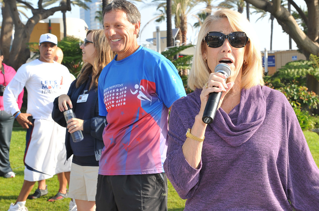 . 10/12/13 - Jane Netherton, president and CEO  od International City Bank pumps up the crowd at the start  of The Aquarium of the Pacific Kids Fun Run the day before the Long Beach International City Bank marathon & half marathon. (Photo by Brittany Murray/Press Telegram)