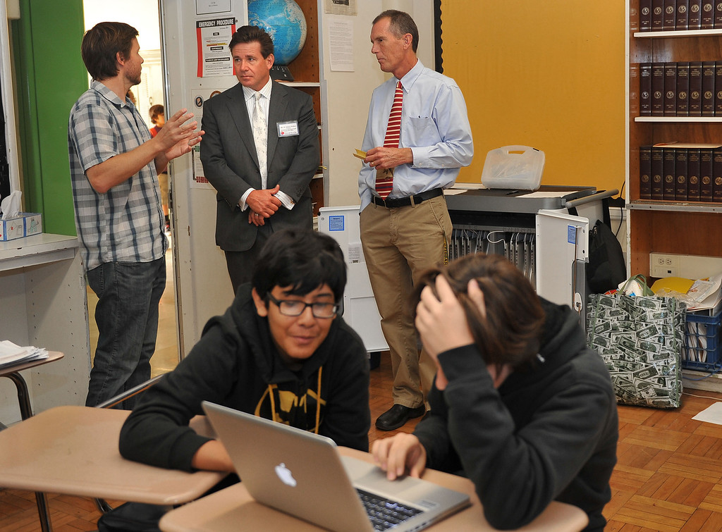 """. 10/16/13 - L-R Jeff Montooth, teacher,  co-pricnicpal Joe Carlson and President of Farmers and Merchants Bank, Henry Walker, observe a classroom at Poly High School on Wednesday morning. Walker was participating in \""""Principal for a Day,\"""" an event that brings community members from the Greater Long Beach Area into schools in the role of the principal. It is co-sponsored by the Long Beach Area Chamber of Commerce, the Long Beach Unified School District and the Long Beach Education Foundation. (Photo by Brittany Murray/Press Telegram)"""