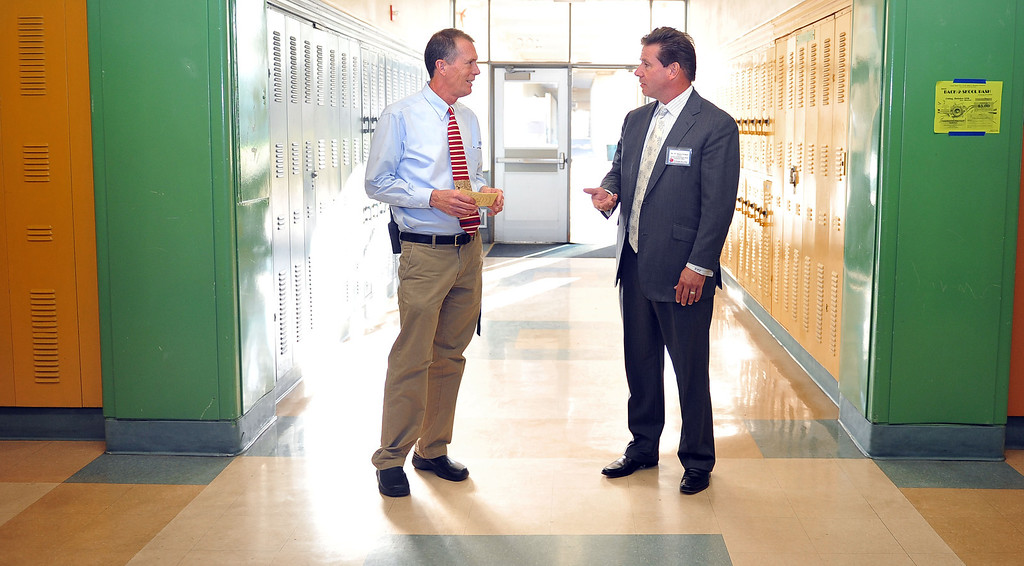 """. 10/16/13 - L-R Co-Pricnicpal Joe Carlson takes President of Farmers and Merchants Bank, Henry Walker, on a tour of Poly High School on Wednesday morning. Walker was participating in \""""Principal for a Day,\"""" an event that brings community members from the Greater Long Beach Area into schools in the role of the principal. It is co-sponsored by the Long Beach Area Chamber of Commerce, the Long Beach Unified School District and the Long Beach Education Foundation. (Photo by Brittany Murray/Press Telegram)"""