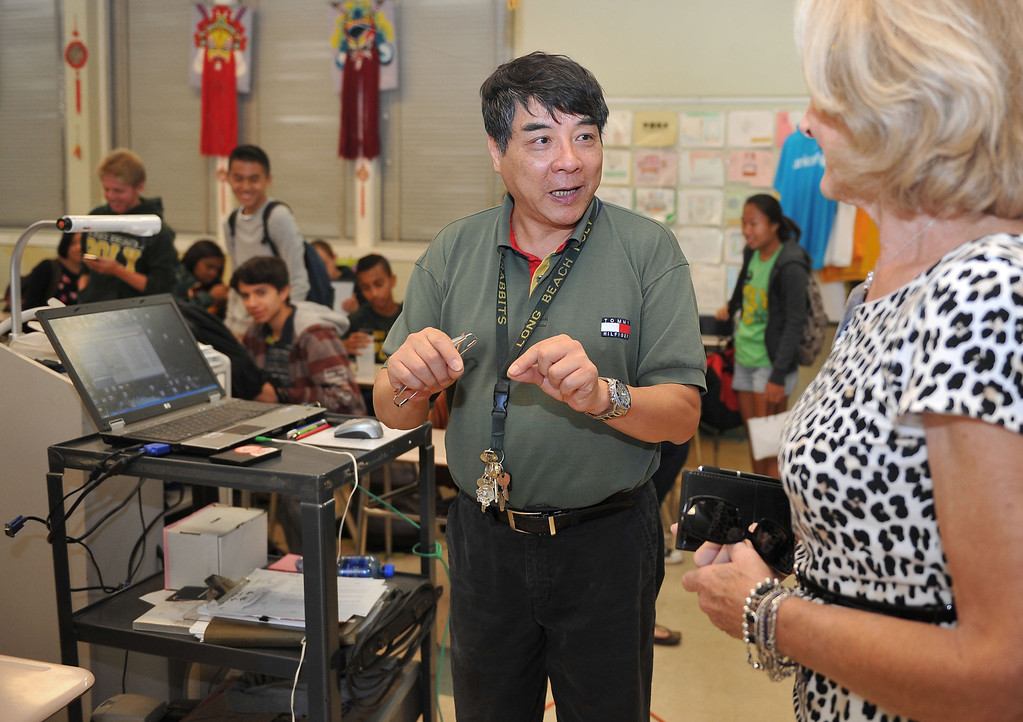 """. 10/16/13 - Dr. Zhu talks with Colleen Bentley at Poly High School on Wednesday morning, about the students language project to give directions from the school to a Long Beach landmark in Chinese. Bentley was participating in \""""Principal for a Day,\"""" an event that brings community members from the Greater Long Beach Area into schools in the role of the principal. It is co-sponsored by the Long Beach Area Chamber of Commerce, the Long Beach Unified School District and the Long Beach Education Foundation. (Photo by Brittany Murray/Press Telegram)"""