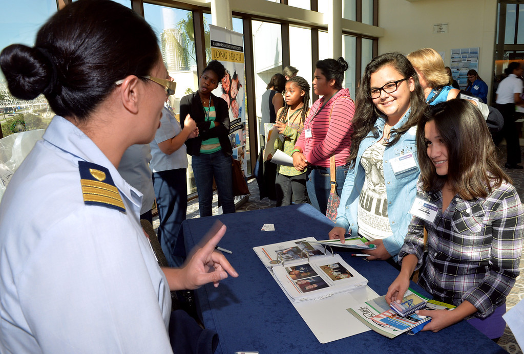 . Christina Davidson, United State Coast Guard talks with Millikan High School students Brillith Orozco, left and Marina Rodriguez, right at the 2013 Celebrating Women in Trade luncheon in Long Beach on November 14. This is the third event to recognize the important role women play in the field of goods movement and to inspire young women in high school to envision a career in the industry.(Photo by Brittany Murray/ Press Telegram)