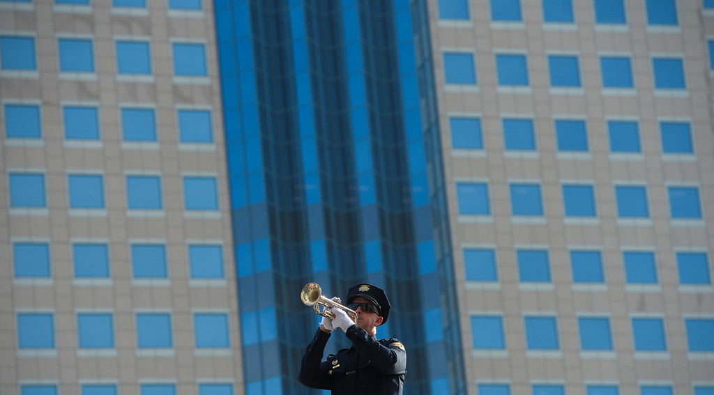 . A Long Beach police officer plays TAPS to close the Long Beach memorial, �Lest We Forget,�  for Pearl Harbor 75th anniversary at the Civic Center Plaza in Long Beach, CA. Wednesday, December 7, 2016. Long Beach Mayor Robert Garcia, Historical Society President Niki Tennant and California Department of Veterans Affairs Secretary Vito Imbasciani were among the speakers at the free event.(Photo by Thomas R. Cordova, Press-Telegram/SCNG)