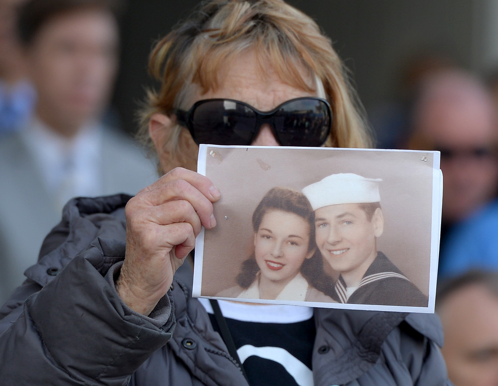 . Patricia Zaid, of Long Beach, hold a photo of her mother and father who served in the Navy as she attends the Long Beach memorial, �Lest We Forget,�  for Pearl Harbor 75th anniversary at the Civic Center Plaza in Long Beach, CA. Wednesday, December 7, 2016. Long Beach Mayor Robert Garcia, Historical Society President Niki Tennant and California Department of Veterans Affairs Secretary Vito Imbasciani were among the speakers at the free event.(Photo by Thomas R. Cordova, Press-Telegram/SCNG)