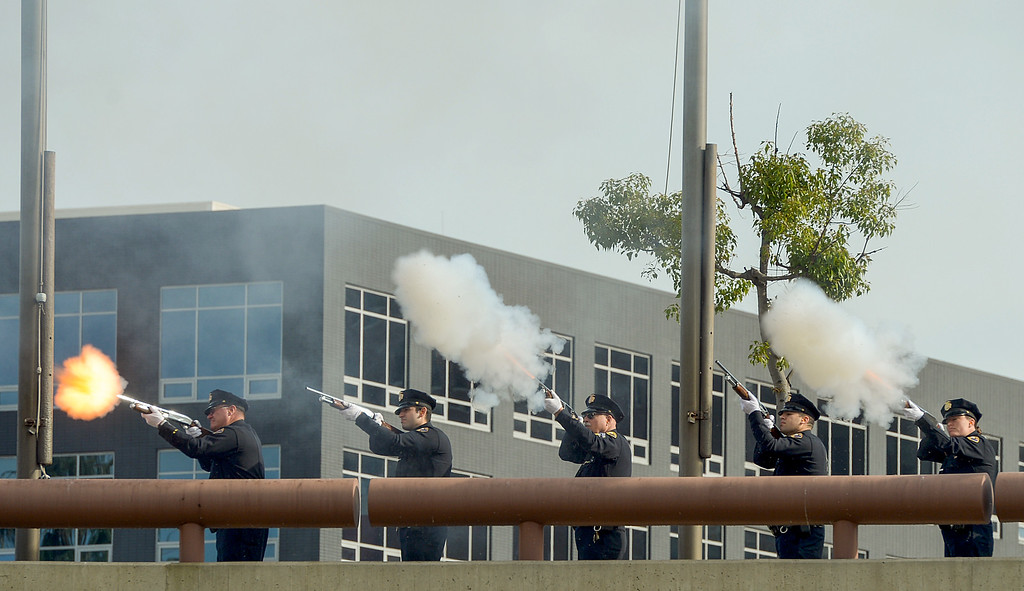 . Long Beach police officers do a 21 gun salute at the Long Beach memorial, �Lest We Forget,�  for Pearl Harbor 75th anniversary at the Civic Center Plaza in Long Beach, CA. Wednesday, December 7, 2016. Long Beach Mayor Robert Garcia, Historical Society President Niki Tennant and California Department of Veterans Affairs Secretary Vito Imbasciani were among the speakers at the free event.(Photo by Thomas R. Cordova, Press-Telegram/SCNG)