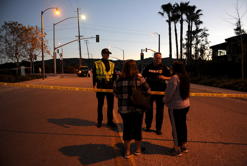 . Two women speak with officers about being escorted to their home, where they were earlier evacuated from, to pick up clothing and personal items as authorities work a barricade situation in Loma Linda, Calif. on Wednesday, Dec. 28, 2016. Nearby homes were evacuated, and a local roadway was closed. (Micah Escamilla/Redlands Daily Facts, SCNG)