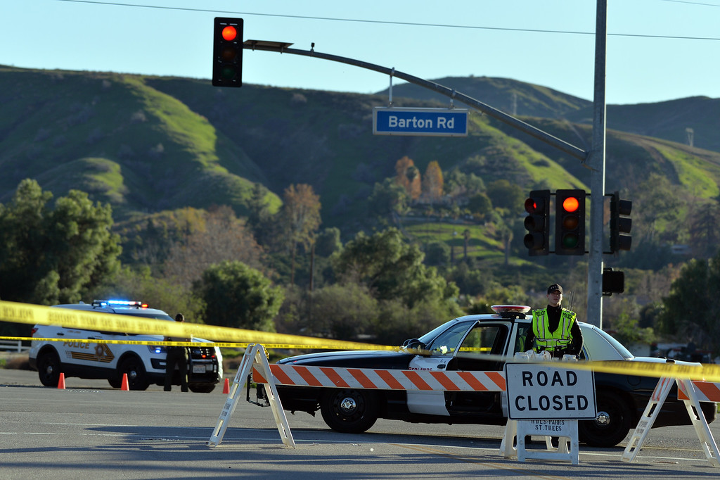. Authorities say a parolee-at-large armed himself with a long gun and then barricaded himself in a home in Loma Linda, Calif. on Wednesday, Dec. 28, 2016. Nearby homes were evacuated, and a local roadway was closed. (Micah Escamilla/Redlands Daily Facts, SCNG)