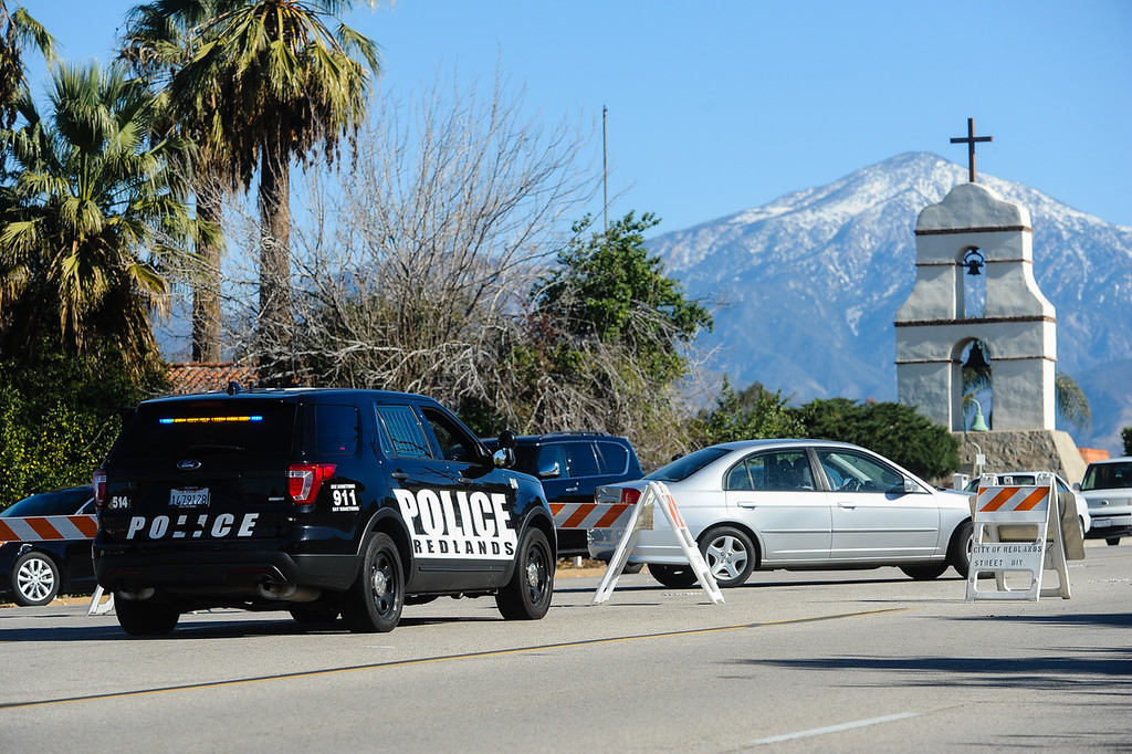 . Redlands police diverts traffic away from Barton Road and Nevada Street near a police scene where authorities say a parolee-at-large arm himself with a long gun and then barricaded himself in a home in Loma Linda, Calif. on Wednesday, Dec. 28, 2016. Nearby homes were evacuated, and a local roadway was closed. (Photo by Rachel Luna/Redlands Daily Facts, SCNG)