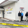 John P. Cleary |  The Herald Bulletin<br /> Elwood police investigate an armed robbery at Low Cost Prescriptions on south Anderson Street where one robbery suspect was shot by police.