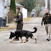 John P. Cleary |  The Herald Bulletin<br /> K-9 officers from Elwood police and Sheriff's dept. search the area around Low Cost Prescriptions on south Anderson Street in Elwood after being robbed Wednesday morning.