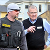 John P. Cleary |  The Herald Bulletin<br /> The Elwood Low Cost Prescriptions pharmacist, right, talks with a Sheriff's deputy after the store was robbed Wednesday morning.