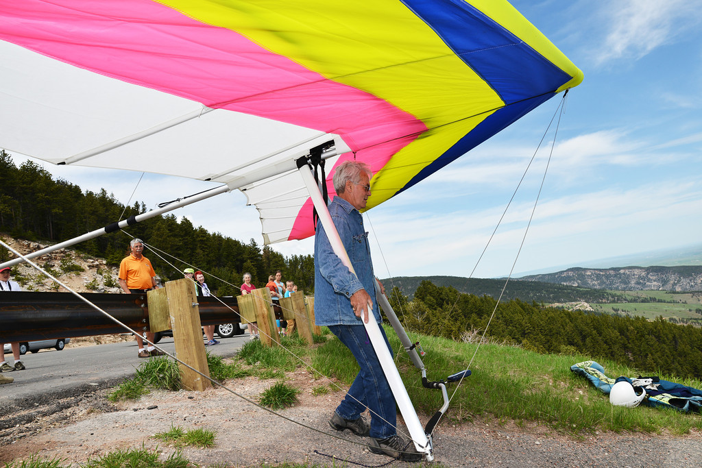 Local pilot Johann Nield carries over his brother-in-law's hang glider to the launch strip Saturday at sand turn on Highway 14 West of Dayton. Memorial Day weekend brings hang glider pilots from the region to the annual fly-in at sand turn in the Bighorn Mountains. Sand turn is known among hang glider and paraglider enthusiasts for good winds and thermal updrafts, which makes ideal flight conditions.