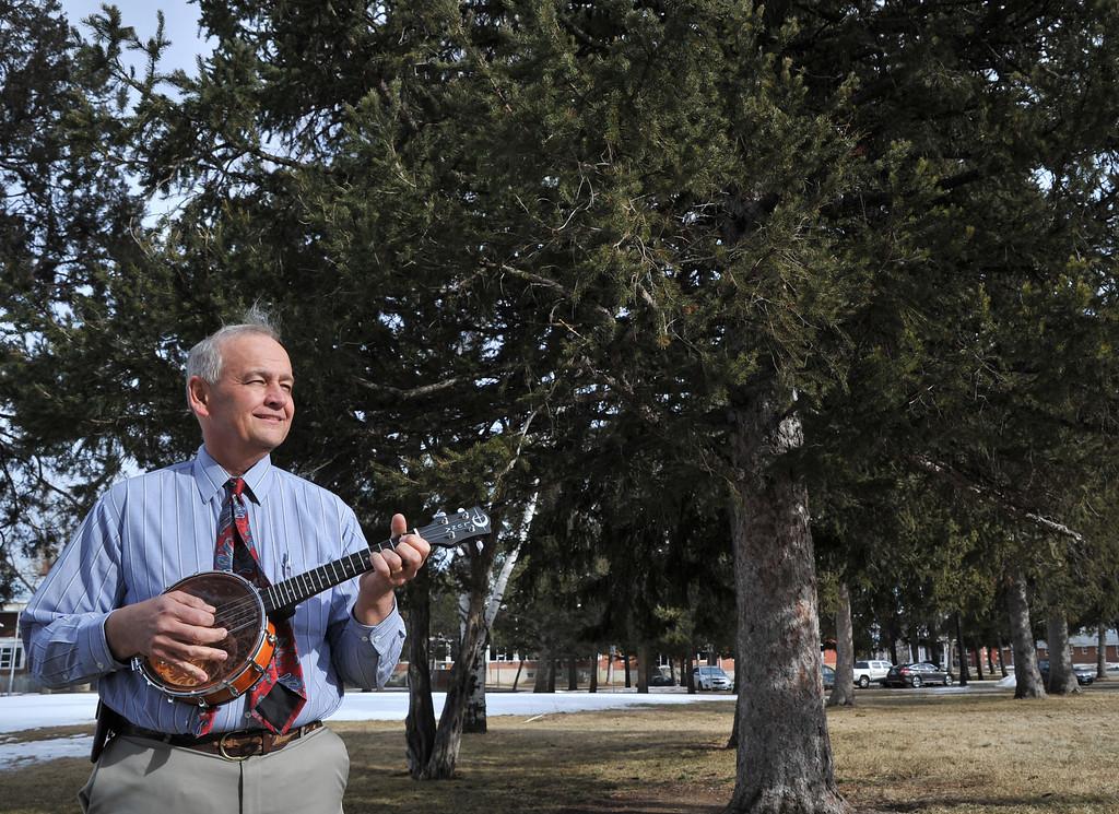 "Jim Hardin plays the Banjolele outside at the VA Medical Facility Friday afternoon. ""I only got into music because I got an 'F' in Algebra."" Says Hardin. During his childhood Hardin was grounded for six weeks and confined to his room where he learned sheet music and practiced on the guitar."