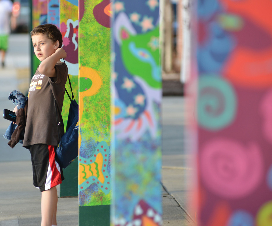 Michael Ligocki, 9, looks out into the parking at the entrance to the YMCA as he waits for his mother to pick him up Thursday evening.