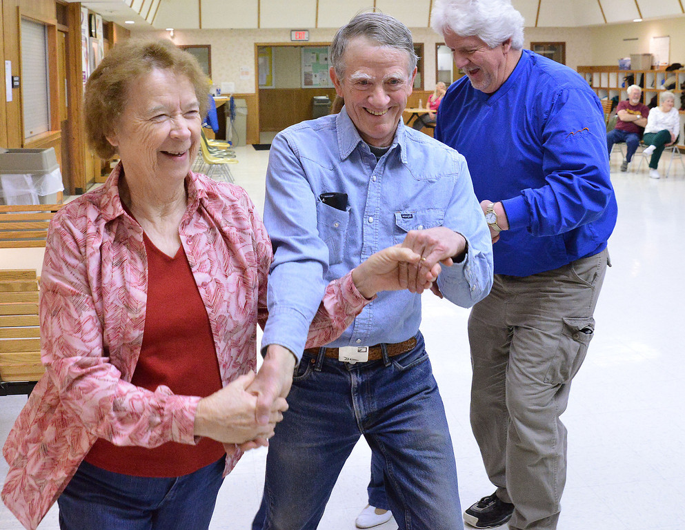 Peggy David, left, dances with Dan Goodenough dancer during a practice session by the Jeans and Queens Square Dance Club Tuesday evening at the Sheridan YMCA. The Cowtown Hoedown will be held at the YMCA May 16 and 17.