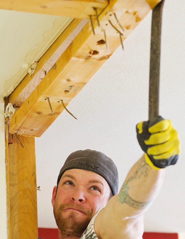 "Bryce Flanders uses a flat bar to pry loose a 2x4 plank from the ceiling at the old Legends restaurant Saturday in Ranchester. The new owner will be remodeling the building and opening a new family-friendly restaurant called ""Eat Street"" which is expected to open by the end of this May."