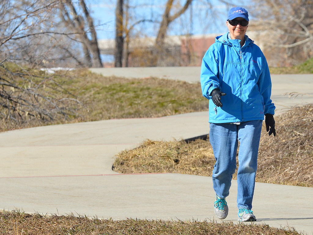 Beth Manthei enjoys a morning walk on the first day of spring Thursday on the pathway between Sheridan Memorial Hospital and Sam Mavrakis Pond. Manthei says that she walks every day along Sheridan's pathways.