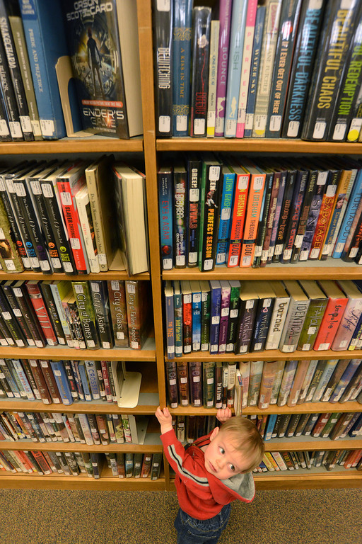 10-month-old Jhett Johnson explores the bookshelves Tuesday morning at the Tongue River Branch Library in Ranchester.
