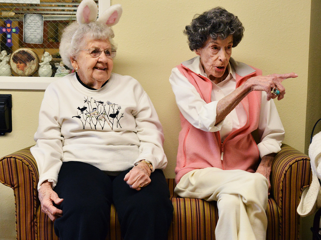 Pauline Mudroch, left, watches as Lois Washut points to a child during an Easter Egg hunt Tuesday morning at the Emeritus at Sugarland Ridge. The pre-kindergarten students from Holy Name Catholic School sang songs for the Sugarland residents before embarking on an egg hunt through out the building. Sugarland residents helped with the event by handing out candy and toys during the event.
