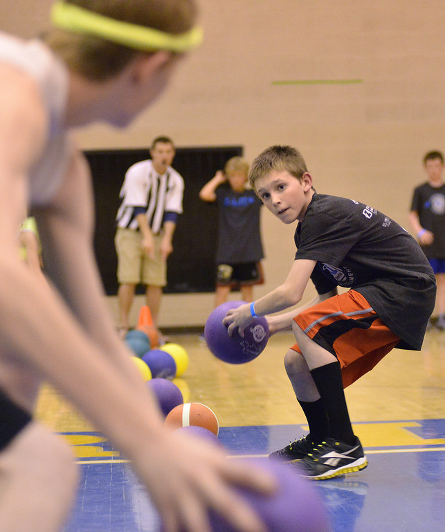 Eli Phillips of the 'K-Life All Stars' sees his predicament after picking up a ball during the K-Life Dodgeball Tournament Saturday at Sheridan High School.