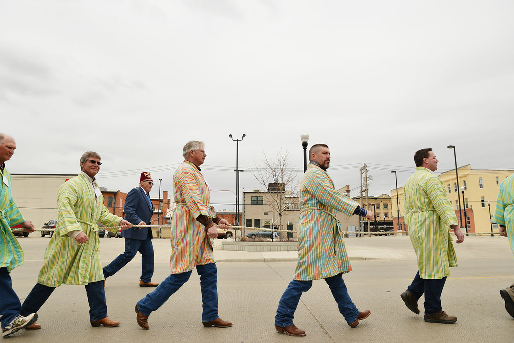 The Kalif Shriner candidates march along with the ceremonial parade on N. Brooks street Saturday. The Kalif Shrine held their Spring Ceremonial Parade as an initiation rite for their new candidates seeking to become members.