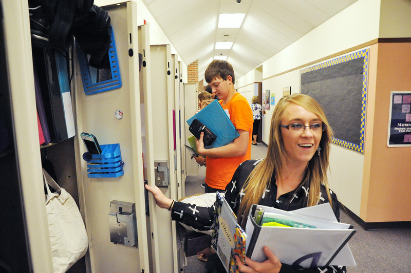 Clearmont High School senior Linzee Adamson opens her locker after the bell on the first day of school for in Sheridan County School District 3 Wednesday at Clearmont Schools in Clearmont. The school year begins earlier in SCSD3 with a four-day school week for the 83 students enrolled in K-12. SCSD3 Superintendent Charles Auzqui says that he is excited to see the results from the student body leadership after recent changes have increased student-lead involvement in the schools. The Sheridan Press|Justin Sheely.