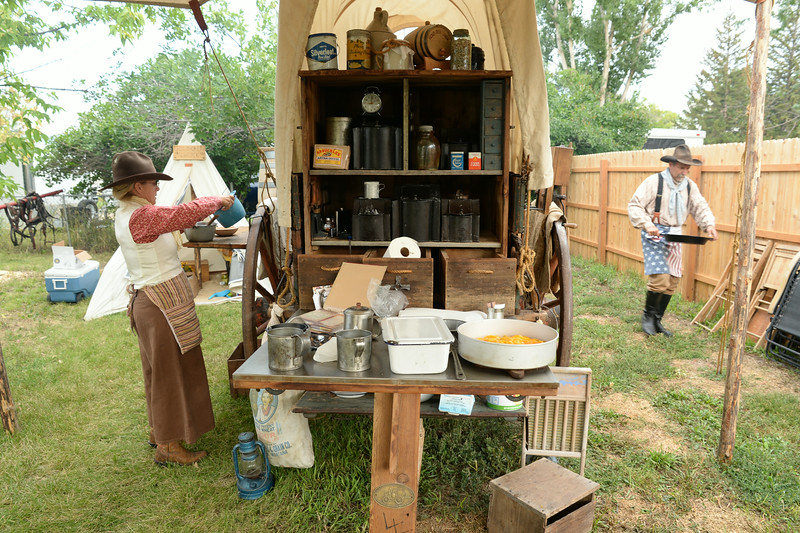 Georgianna Lipus, left, and Frank Lipus of Hamilton, Montana, prepare the meal for the chuckwagon cook off during Big Horn Heritage Days celebration Saturday at Big Horn. Several cooks from parts of Montana and South Dakota brought their old time chuckwagons to the cook off event and prepared meals to be judged. Each Chuckwagon was also judged on appearance and accuracy to the time period of the old cattle driving days of the west. Chuckwagon meal tickets were also sold for those visiting the events in Big Horn. The Sheridan Press|Justin Sheely.