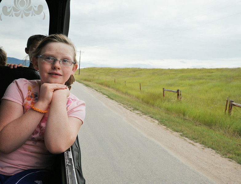 Big Horn third grader Emma Prior looks out the window on the Sheridan Trolley during the Summer Reading Challenge celebration Wednesday on Brinton Road in Big Horn. 31 students took on the 'MyOn Summer Reading Challenge' and read 977 books throughout the summer collectively. The students had to read 10 books or more to receive a medal; the gold medalists read 50 books or more. On Wednesday, the gold medalists were awarded a special trip on the Sheridan Trolley to the Brinton Museum where the director presented gifts to the children. The debut reading program was intended to encourage students to read through the summer.
