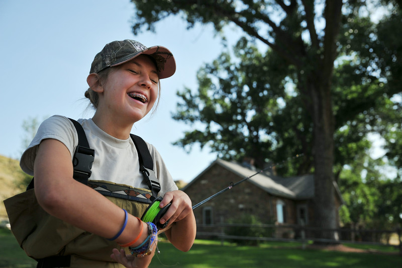Thirteen-year-old Mollie Watson laughs at herself after discovering a mistake assembling her fly rod during 'Adrenalin Camp' with Joey's Fly Fishing Foundation Tuesday at the Kimble Ranch on Highway 14 East. The summer fly fishing camps are leading up to the Fall Fly Tournament coming this September 19 and 20 at Piney Creek on the Kimble Ranch. The Sheridan Press|Justin Sheely.