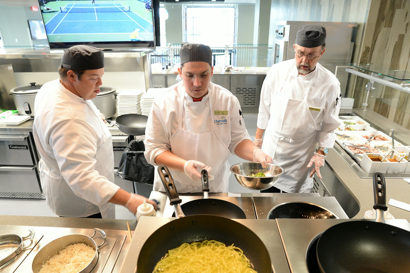 Cooks Jacob Schirmer, left, AJ Steven, and Hollingsworth Scott, right, make a stir-fry meal for a customer during lunch Friday in the Thorne-Rider Campus Center at Sheridan College. The new campus center features restaurant quality meals with the option of an all-you-can-eat buffet. The restaurant is open to the public for breakfast, 7 a.m. to 10 a.m., lunch, 10:30 a.m. to 2 p.m., and dinner from 5 to 7 p.m. The brick oven style pizza parlor on the lower level is open until midnight. The Sheridan Press|Justin Sheely.