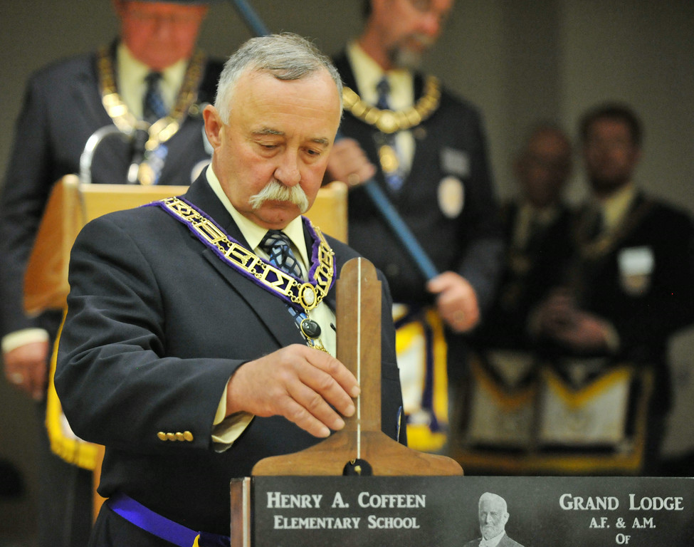 Mike Johnson, Senior Grand Marshal of the Grand Lodge AF & AM of Wyoming, uses a ceremonial level to test the cornerstone during the Cornerstone Dedication Ceremony at the new Henry A. Coffeen Elementary School gymnasium Saturday afternoon on South Sheridan Avenue. The masonic level, among other tools used in masonry, is symbolic for moral virtues. The Masonic Grand Lodge AF & AM of Wyoming commenced the ceremonies for the dedication of the cornerstone at the site of the new elementary school named after the former Mason, Henry A. Coffeen.  The masons also authorized a time capsule to be set with a time capsule made by the elementary school, which will be sealed and placed behind the cornerstone at Coffeen School. The Sheridan Press|Justin Sheely.