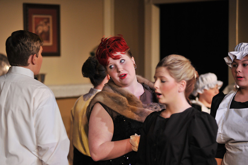 """'Lady Brentwood' by Ashley Velos sings during the musical number """"Never Mind the Dust and Dander"""" during Friday night's performance """"Murder Twice Baked"""" by Fort Mackenzie and the Wright Place students at the Carriage House Theater."""