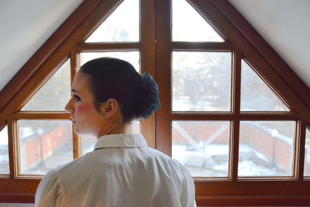 Cecilia Samdahl, as 'Flora,' turns towards another cast member after gazing out the window prior to the Fort Mackenzie High School students' performance of 'Murder Twice Baked' Thursday evening on the second floor of the Carriage House Theater.