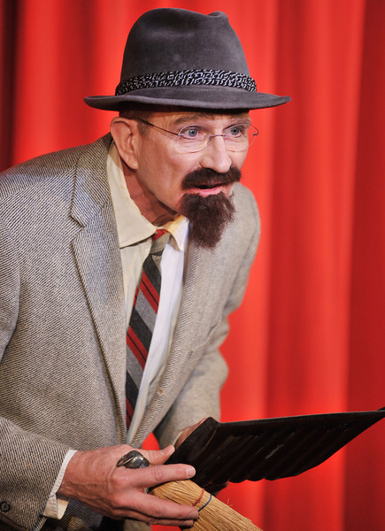 """Director Mick Wiest plays the role of Professor Corium during the performance of """"Murder Twice Baked"""" Friday night by Fort Mackenzie and the Wright Place students at the Carriage House Theater."""