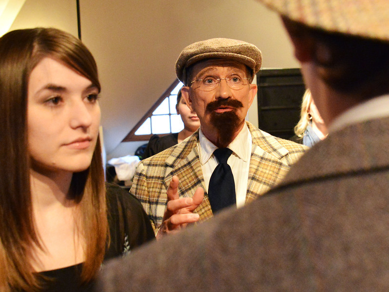 Musical Director Stephanie Zukowski, left, and Performance Director Mick Wiest talk to the cast in the dressing room before the Fort Mackenzie High School students' performance of 'Murder Twice Baked' Thursday evening at the Carriage House Theater.