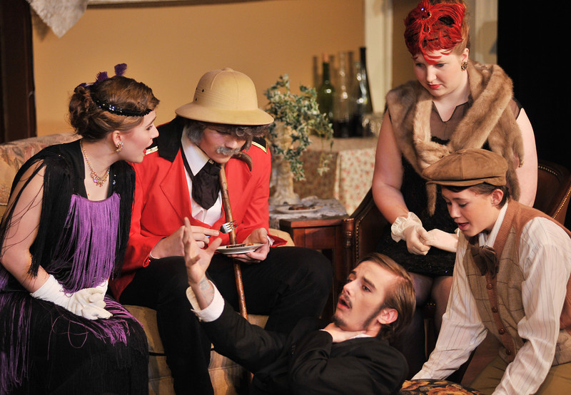 """Michael O'Kelly as 'Birch' gasps for air as he dies from a bite of poisoned rhubarb during the performance of """"Murder Twice Baked"""" Friday night by Fort Mackenzie and the Wright Place students at the Carriage House Theater. Cast members from left, Gabbie Migrants, Austin Channel, Ashley Velos, and Cade Neeson look on."""