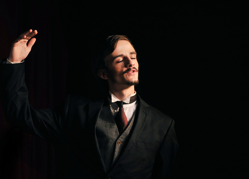 """'Birch' by Michael O'Kelly holds an exalted posture in the song """"The Favorite Son"""" during Friday night's performance """"Murder Twice Baked"""" by Fort Mackenzie and the Wright Place students at the Carriage House Theater."""