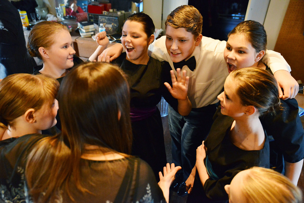 Fort Mackenzie High School students gather in a huddle with the music director prior their performance 'Murder Twice Baked' Thursday evening at the Carriage House Theater. Top, from left, Cheyenne Feley, Lauren Sodergren, Adam Bakkehaug, and Alex Ray Bautista.
