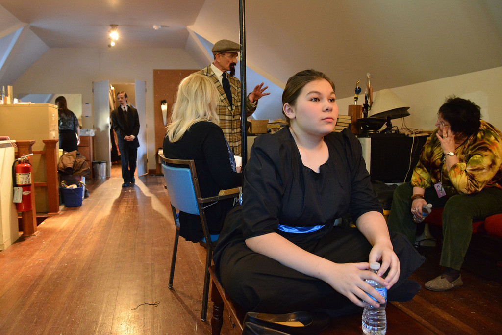 Alex Ray Bautista waits with a bottle of water in hand as cast members get ready for the show prior to the Fort Mackenzie High School students' performance of 'Murder Twice Baked' Thursday evening on the second floor of the Carriage House Theater.