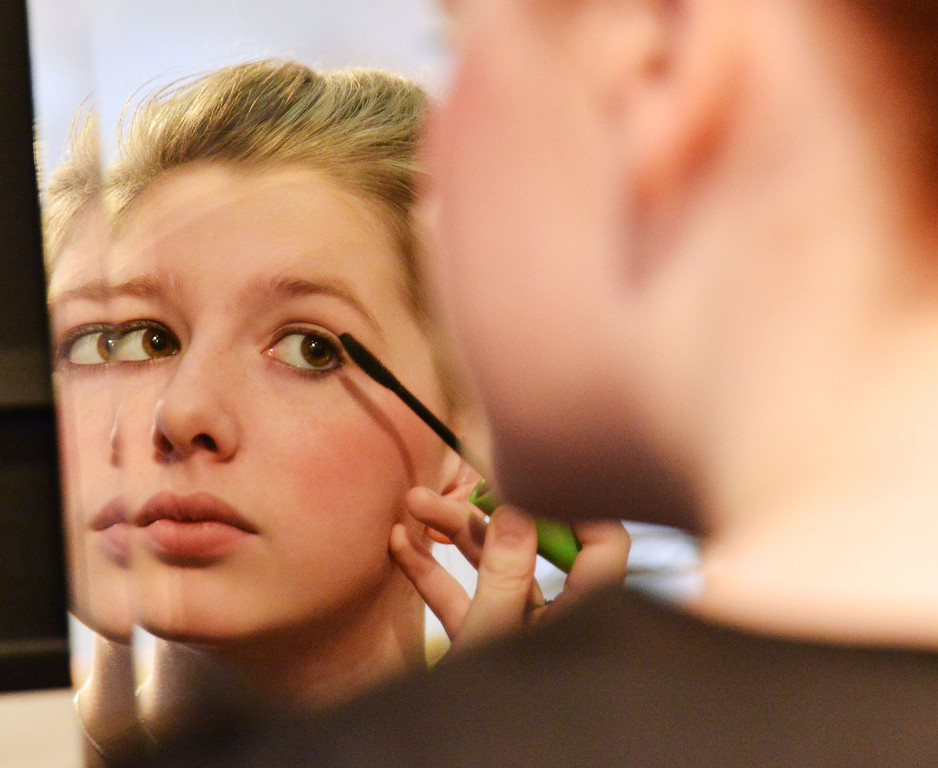 Hannah Johnson, as 'Rose,' applies mascara in the dressing room before the Fort Mackenzie High School students' performance of 'Murder Twice Baked' Thursday evening at the Carriage House Theater.