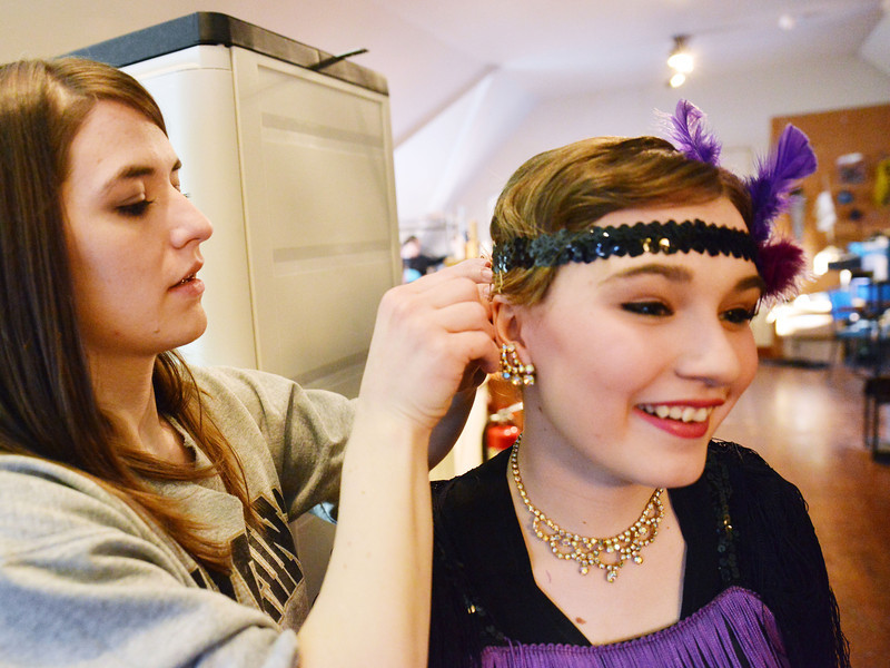Musical Director Stephanie Zukowski makes some final touches to Gabrielle Migrants' costume prior to the Fort Mackenzie High School students' performance of 'Murder Twice Baked' Thursday evening on the second floor of the Carriage House Theater.