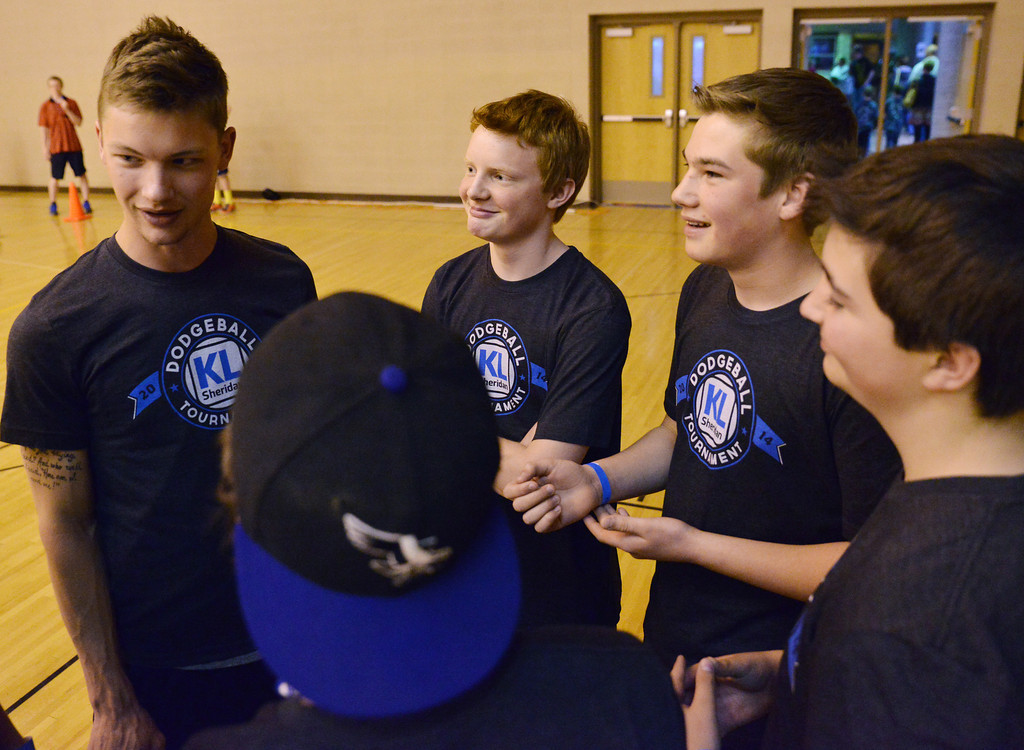 Honey Badgers coach Sumner Ellis, left, talks to the team with Ryan Vrieswyk, middle, and Quinton Brooks listening during the K-Life Dodgeball Tournament Saturday at Sheridan High School.