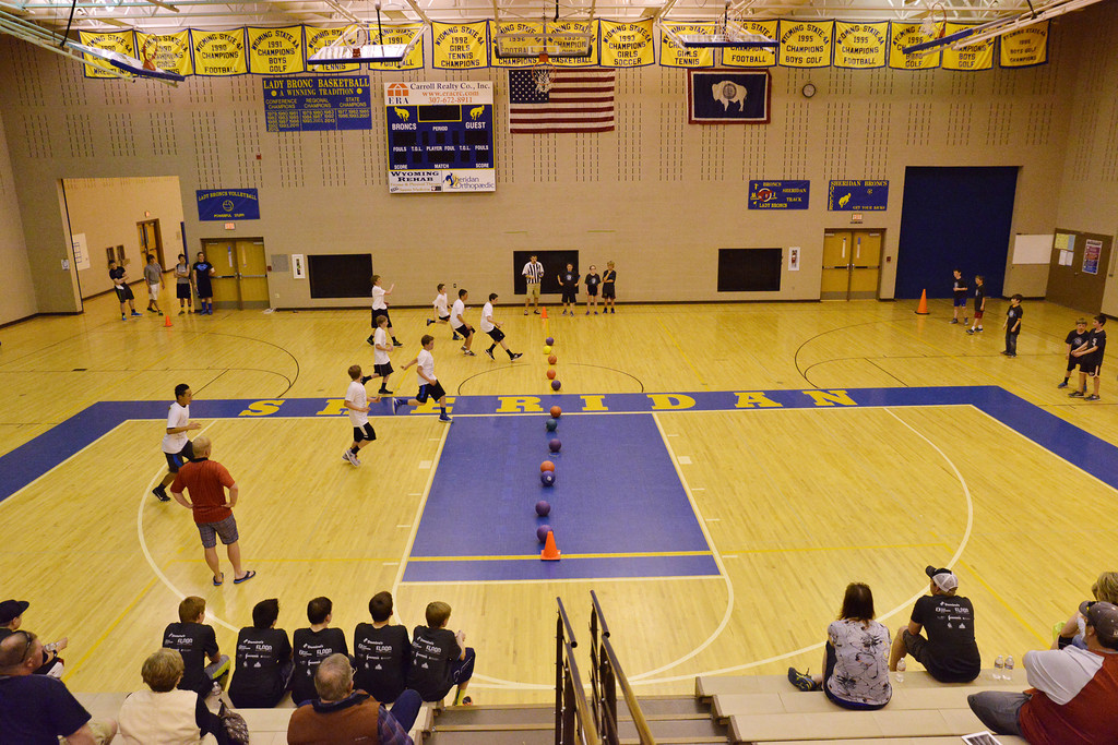 A team rushes for the balls as the other defers to receive and catch during the K-Life Dodgeball Tournament Saturday at Sheridan High School.