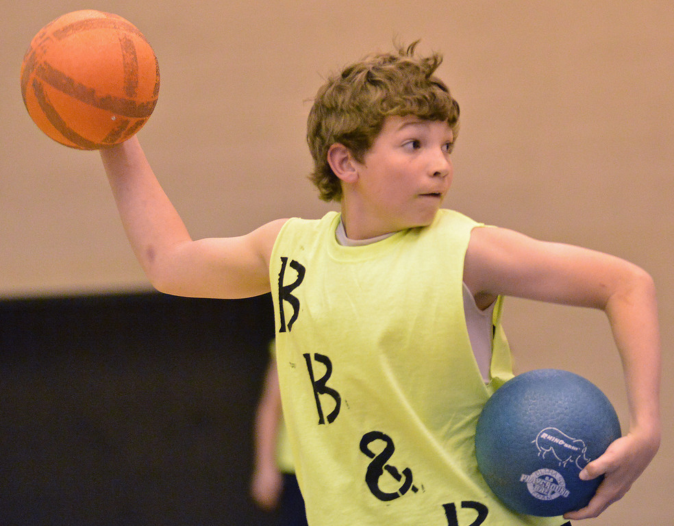Kade Eisele of the 'Blood Bath and Beyond' team aims down the court during the K-Life Dodgeball Tournament Saturday at Sheridan High School.