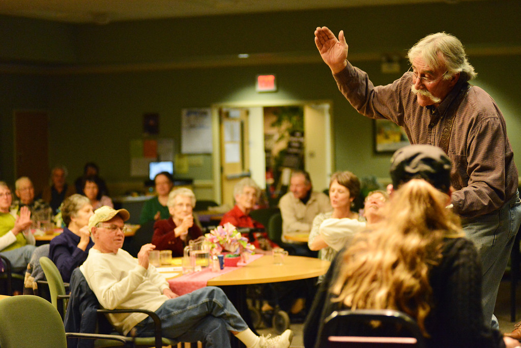 """Lynn Young leads the audience participation in """"She'll be Comin Round the Mountain"""" during the Bluegrass Open Mic Jam Session Tuesday at the Sheridan Senior Center. The group consists of local musicians, most of whom are from Lynn Young's jam class. The group jams with the public during dinnertime every third Tuesday of the month at the Sheridan Senior Center."""