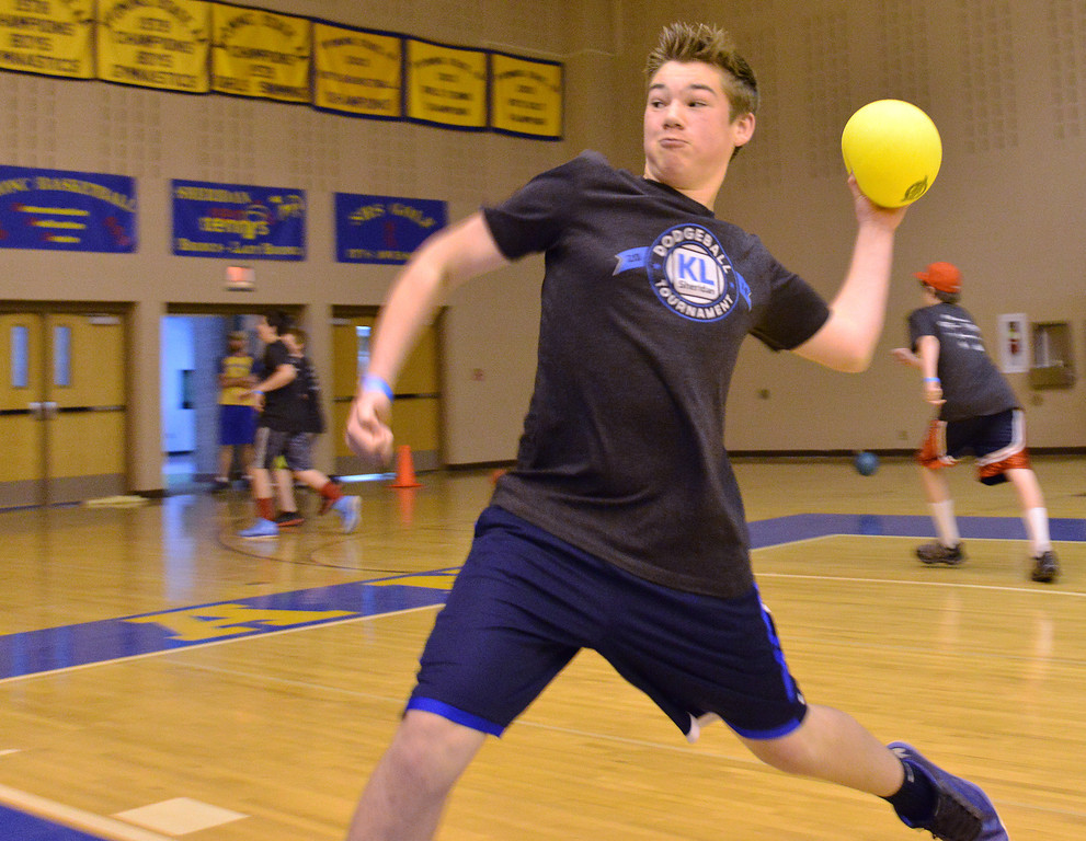 Quinton Brooks of the Honey Badgers throws a ball at the other team during the K-Life Dodgeball Tournament Saturday at Sheridan High School.