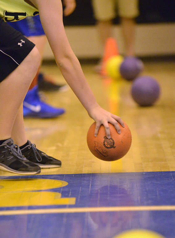 A player grabs a ball during a match at the K-Life Dodgeball Tournament Saturday at Sheridan High School.